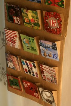 advent calendar made with paper lunch bags and magazine pictures.  I think I will try with card stock paper and old x-mas cards.