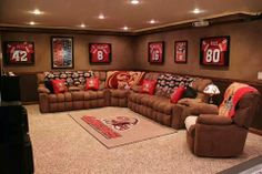 °This is my dream basement. I love everything. couch. recliner. throw blankets and pillows. lamp. rug. projector. art work evenly spaced°