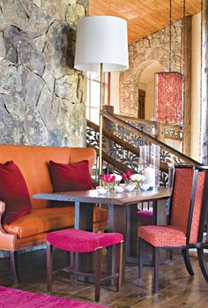 The fuchsia suede upholstery creates a colorful vibrance in this mountain inspired home. Via @luxemagazine