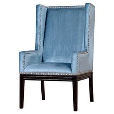 """Velvet wingback arm chair with nailhead trim and a solid wood frame.   Product: ChairConstruction Material: Solid wood and velvetColor: BlueFeatures: Wingback silhouetteNailhead trimDimensions: 46.4"""" H x 26.7"""" W x 31.1"""" D"""