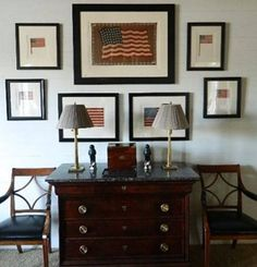 Entry | Simetrical grouping using Vintage dresser or Magazine rack console. Antique chair with reupholstered seat. Framed Americana calendar prints. Flags. Brass table lamp with updated lampshade. Ceramic spreadwinged eagle. Blue Longaberger pottery. Mirrored key cabinet.  Americana fabric liner for umbrella basket.