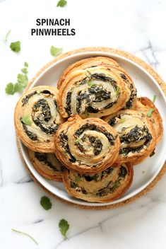 Vegan Spinach Pinwheels. Creamy Cheesy Vegan Spinach dip spread on puff pastry, rolled, sliced and baked to make a great Snack. Vegan Soyfree Recipe.