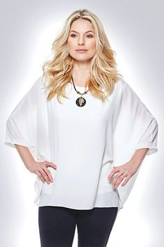 White Batwing Sleeve Blouse £25.00 This gorgeous airy top is available in black or white and comes with a complementary necklace. One size fits 10-16. 50% polyester, 50% viscose. Lined, machine washable.