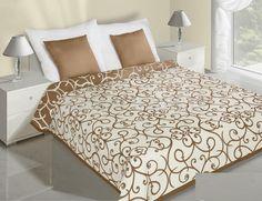 Dwustronne narzuty w kolorze beżowo kremowym na łóżko