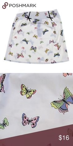 Grace Elements butterfly print skirt GRACE ELEMENTS PETITE darling skirt with butterflies size 8P material is 97% cotton and 3% spandex so stretchy for comfort. Hidden side zipper. Unlined.   lovely pastel butterflies skirt is accented with  little ribbon bows Grace Elements Skirts A-Line or Full