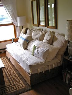 Make your own couch using a twin mattress.   Hoping to make this for our reading nook!