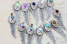 Would love garnet for petey!! Mothers Necklace Custom Birthstone Wing by inspiredbyelizabeth, $39.00