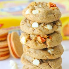 Soft, puffy, chewy pumpkin spice cookies stuffed with bits and pieces of pumpkin spice Oreos and white chocolate chips.