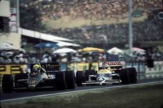 The overtaking of the century, 1986 Hungary GP, Hungaroring. Nelson Piquet, in the Williams Honda (blue and yellow car) overtakes Ayrton Senna in the Lotus (black car) on the outside and slides his car on all four wheels along the corner to use the maximum amount of track and avoid Senna taking back the first place