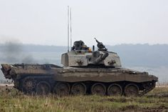 A Challenger 2 main battle tank is pictured during manoeuvres on Salisbury Plain near Warminster.