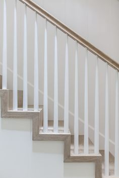 """Staircase. Staircase balusters. 4 treads with 2"""" mitered skirting for transitional look. Tapered balusters with NO transition post at corners for cleaner look What a great take on staircase balusters! I am loving this new fresh look! Winkle Custom Homes. Melissa Morgan Design. Ryan Garvin Photography"""