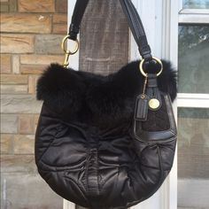 Cuddle with the bunny Coach No. G05K-3586 For you collectors, SUPER HARD to find Authentic Coach Limited Edition Rabbit Fur Signature Quilted Hobo Bag 3586 In BLACK!!! This is a gorgeous and very unique purse. The rabbit fur is soooo soft! This is the perfect bag for holiday parties and special occasions. It was a gift and I have never used it. I don't collect, so, it must go to a loving home  Coach Bags