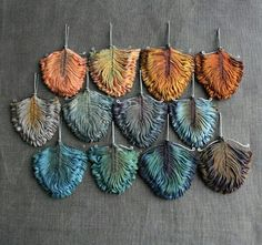 Tinctory makes smocked textile jewelry made from naturally dyed silk using these ingredients:  indigo (including home grown), coreopsis (home grown), madder, walnut, onion, logwood, hawthorne, goldenrod and tea.