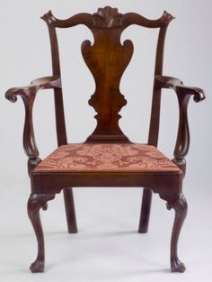 Northeast Auctions - JiII & Mickey Baten Collection.  Aug. 15, 2015. Lot # 516.    Est. $15,000-$25,000.   Sold: $9,300 ($7,750).   Description:   FINE QUEEN ANNE CARVED-WALNUT ARMCHAIR, PHILADELPHIA, PENNSYLVANIA, CIRCA 1760, having a cupid's bow crest centered by a carved shell and molded ears above a fiddle-shaped solid splat of figured walnut, molded serpentine shaped arms ending in volute-carved knuckle handholds continuing to scooped incurved arm supports, trapezoidal seat with…