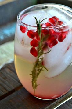 Pomegranate & Rosemary White Sangria  Ingredients:  1 bottle of dry white wine3/4 cup pomegranate arils4 springs of fresh rosemary1/4 cup simple syrupthe juice of 1 lemonthe juice of 1 orange 1/3 cup Triple Sec     Directions:  In a large pitcher add everything together.Refrigerate for 24 hours.Serve over ice.
