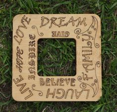 Wood burned Picture Frame featuring the words to live by: love, live, hope, inspire, dream, give, believe, laugh and family. Frame has been