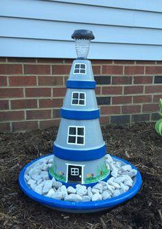 Terra cotta pots n solar light makes a cute lighthouse