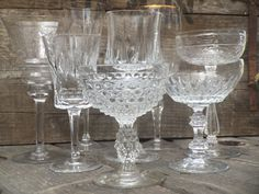 eclectic mix of clear glassware: champagne flutes, coupes and goblets. Mintage Rentals provides modern + vintage rentals for staging and special events.