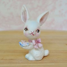Vintage White Rabbit Figurine Holding Flowers by NevermoreVintage