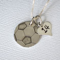 Whether you are a soccer star or only a fan-atic, this hand stamped soccer ball necklace is a sporty accessory to show off your love for the