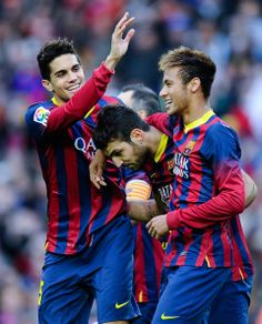 Cesc Fabregas (C) of FC Barcelona celebrates with his teammates Marc Bartra (L) and Neymar after scoring his team's second goal from the penalty spot during the La Liga match between FC Barcelona and Granda CF at Camp Nou on November 23, 2013 in Barcelona, Catalonia.