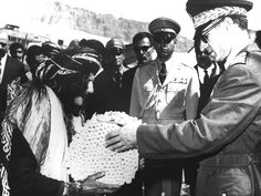 Mohammed Reza Pahlavi hands out deeds during the White Revolution