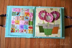 "She calls it ""I spy"" but I call it matching because she put a magnet in each square to match them up. QuietBookWM026"