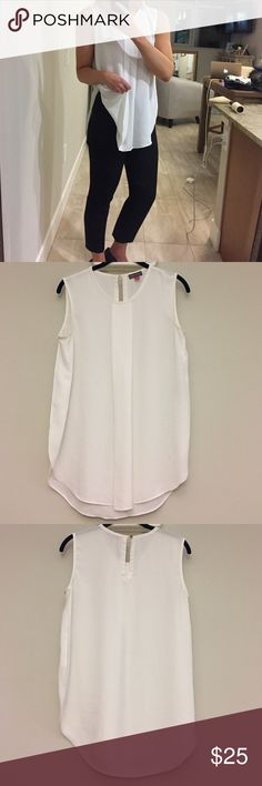 "Vince Camuto Pleat Sleeveless Blouse Front-and-center box pleat. Deep side vents / slits and a high/low gem. 23.5"" front length from neckline, 29"" back length from closure to the bottom. Back keyhole with button loop closure. 100% Polyester. Machine wash cold. Vince Camuto Tops Blouses"