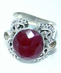 Beautiful item with Ruby, Peridot Faceted Gemstone(s) set in pure 925 sterling silver.