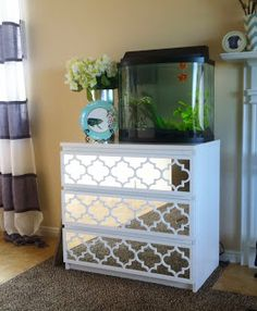 DIY overlay with mirror to spiff up ikea chest of drawers.  See ALSO how to make own mercury glass / antique mirror using vinyl sheet & spray pain