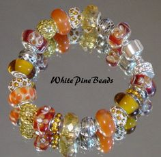 NEW Fall Leaves Gold, Amber and Orange European Style Charm Murano Glass Bead Bracelet. $39.50, via Etsy.