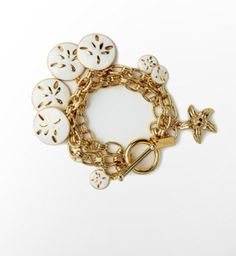 Cute charm bracelet with sand dollars!!!! Perfect for a nice event at the beach!!