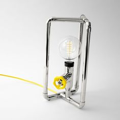 Fun design table lamp with replaceable, colorful dimmer knob. Here shown in one of our favorite color combinations - nickel metal finish, fruit yellow braided cord and fruit yellow knob. Industrial spirit with a touch of modern, creative design.