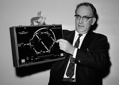 Dr. John W. Mauchly, inventor of some of the original room-size electronic computers, poses in Washington, DC, on November 2, 1962 with one the size of a suitcase after addressing a meeting of the American Institute of Industrial Engineers. He now is working on a pocket variety which, he says, may eliminate the housewife's weekly shopping list and the chore of filling it by hand. He predicted everyone will be walking around with his own personalized computer within a decade.