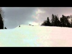 30 skiers do a backflip while holding hands