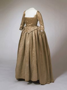 A Quaker Woman's dress, made from beige plain weave and beige silk satin, circa 1799
