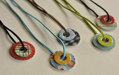 DIY Trendy Washer Necklaces... looks like either fabric or paper- Mod Podged onto a flat washer from Ace Hdw..with leather cord for chain.  Cool.