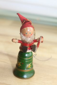 Vintage wooden Ornament - Santa sits on a bell - handpainted on Etsy, $8.00