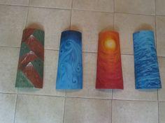 los cuatro elementos: tierra. aire, fuego y agua pintados en tejas