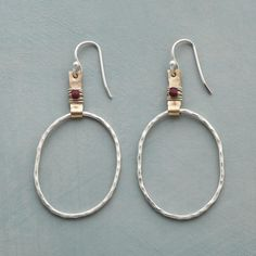BLAZE BRIGHT HOOP EARRINGS--Hammered sterling silver hoops and 14kt gold-filled tabs show off the silversmith's skill, while fiery…