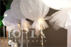 Balloons with tulle & fairy lights                                                                                                                                                      More