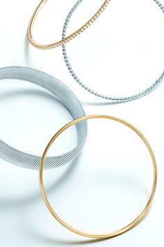 Tiffany & Co. bangles, from top: Tiffany Metro in 18k gold with diamonds, Tiffany Twist in sterling silver, Tiffany Somerset™ narrow domed bangle in sterling silver and Tiffany Bezet™ in 18k gold. #TiffanyPinterest