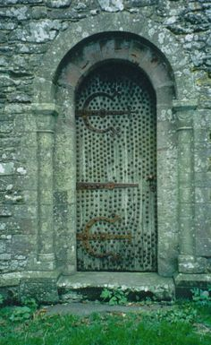 Scotland:  The locked door of Cruggleton's old church.  The church apparently hasn't been used in many years and stands hidden within a grove of trees.