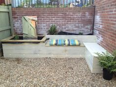 J Shardlow Gardens :Sutton Ave newly completed with sleeper built pond, seating and border against retaining corner wall