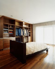 When space is tight, designers often eke out additional (hidden) square footage by going deep—into the walls and furnishings themselves. Built-in shelving, closets, and creative, multipurpose built-ins maximize storage and can make even a tiny space more functional and beautiful. Here are some of our favorite examples of smart storage in small spaces.