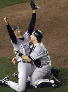 Rivera is hugged by Joe Girardi after closing out the final game of the 1998 World Series against the Padres.