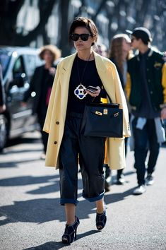 Miroslava Duma's definition of keeping it easy includes statement jewels and chic outerwear.  Source: Gorunway