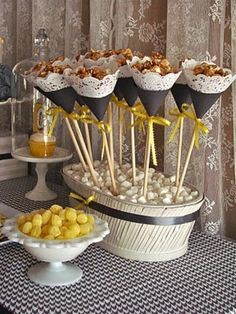 Sweet lemon drops and lacy caramel corn scones nestled into a basket of soft mints were a perfect touch for a baby shower from Oh, Sugar Event Planning. Kino Party, Candied Lemons, Baby Shower Yellow, Popcorn Bar, Popcorn Favors, Paper Cones, Caramel Corn, Candy Bouquet, Dessert Buffet