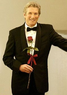 "Best scene in the movie ""Shall We Dance."" Richard Gere coming up the escalator in a black tuxedo holding a red rose. Charming. My husband looks very handsome in a black tuxedo"