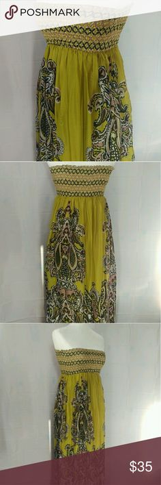 NWOT Olive Green Foral Design Strapless Dress(S) Brand new no tags. Long 41in dress. Waist band stretches to 34in around. Top band that would touch underarms stretches 40in around. Olive green, black and pale plum colored dress. Size small. There is a silky inner lining that is just plain green. no brand Dresses Strapless